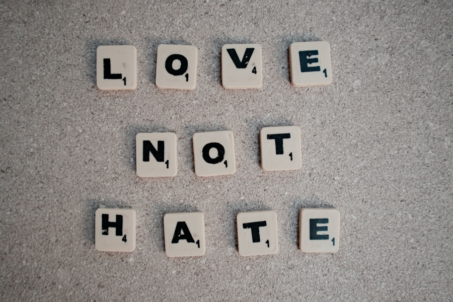 scrabble tiles showing the message Love not hate
